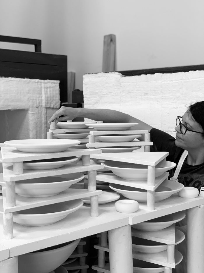 Amy packs the kiln with porcelain pieces.